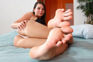 Babe Gives Footjob and Gets Her Toes Covered in Cum from Foot Fetish Daily