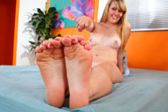 Emma Ash Wraps Her Sexy Feet Around a Black Cock from Foot Fetish Daily
