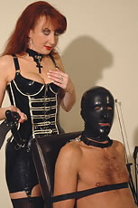 British mature rubber clad mistress from Lady Sonia