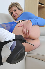 Seamed blue nylons and leg warmers from Lady Sonia