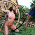 Punished on the medieval wheel from whippedwomen.com