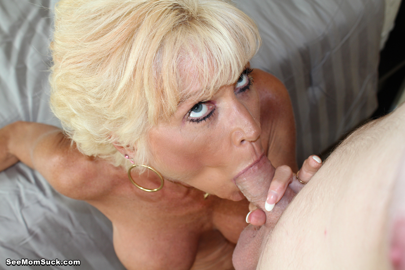 Mature Granny Sucking On A Cock